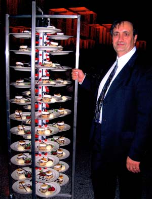 Mike Kazes at a Las Vegas resort & casino standing next to a 84 plate collapsible Plate-Mate PM84-135.